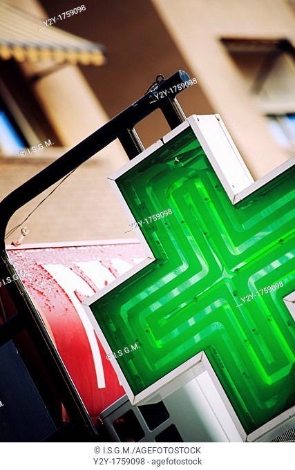 Green cross signal of a pharmacy in Valencia, Spain
