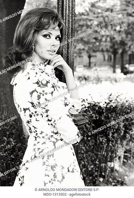 Portrait of Gloria Paul. English actress and singer Gloria Paul posing in a park. Milan, May 1968