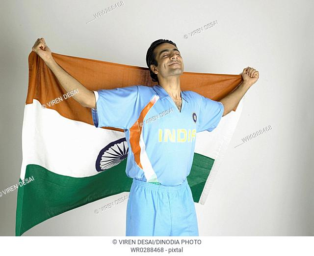 Indian cricket player holding flag of India in his backside MR702A