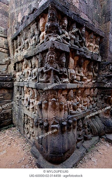 Sandstone bas relief of male figures, Devatas & Nagas of the underworld on the hidden wall at the Leper King Terrace, part of the Royal Square of Angkor Thom -...