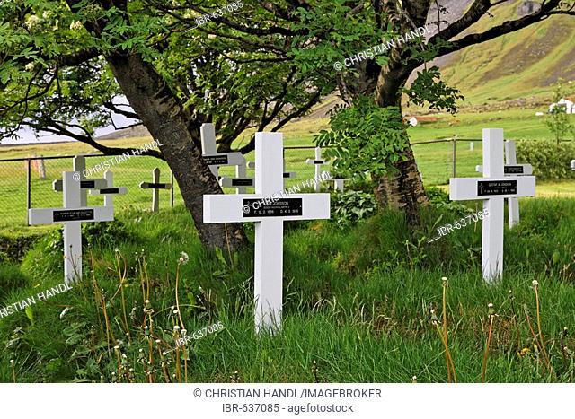 Cemetery at an old heathen church (Hof), southern coast of Iceland, Atlantic Ocean