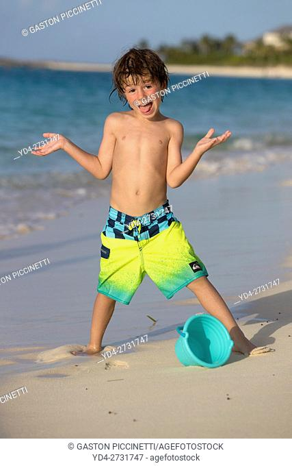 Boy playing in the beach, Cabbage Beach, New Providence Island, Paradise Isalnd, Bahamas
