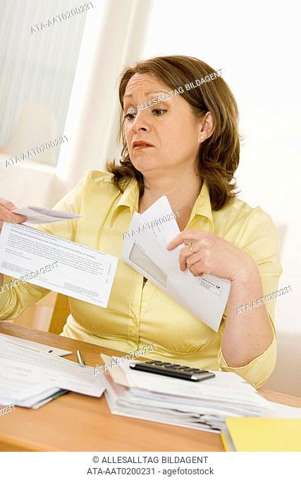 Woman holding official letter in her hands