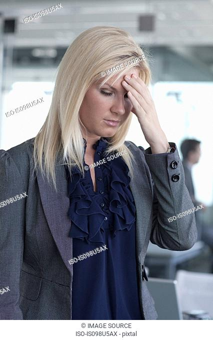 Stressed businesswoman