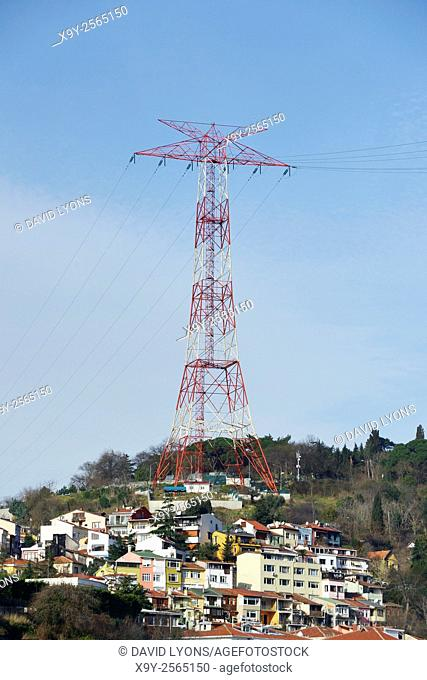 High voltage electric electricity transmission power line cable pylon in Sariyer district of Istanbul, Turkey