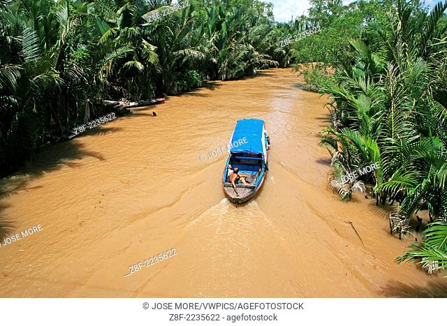 Traditional boats carry freight on the Mekong River and canals near Ben Tre
