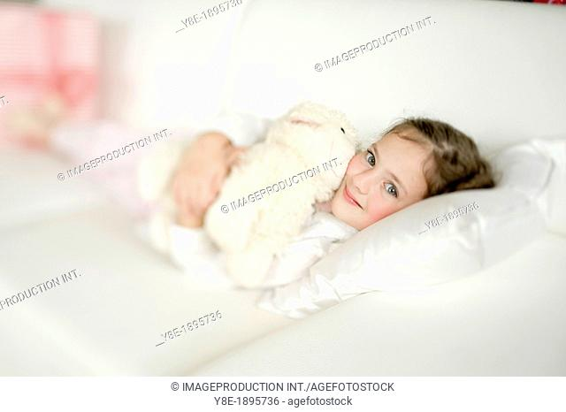 Portrait of cute girl (4-5) with cuddly toy