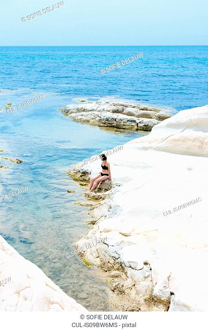 Woman enjoying seaside, Punta Bianca National Reserve, Agrigento, Sicily, Italy