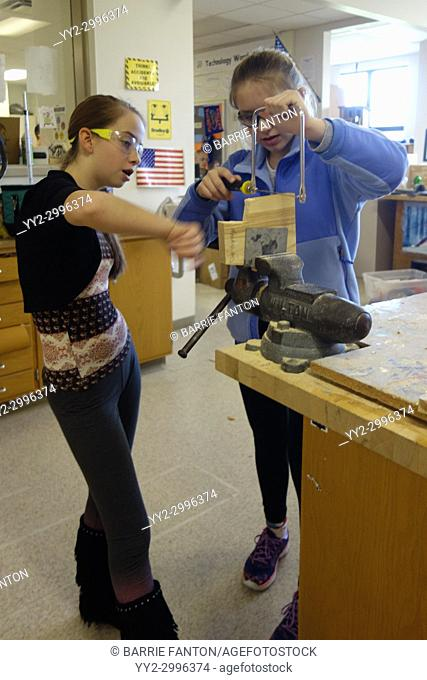 8th Grade Girls Using Coping Saw in Technology Class, Wellsville, New York, USA