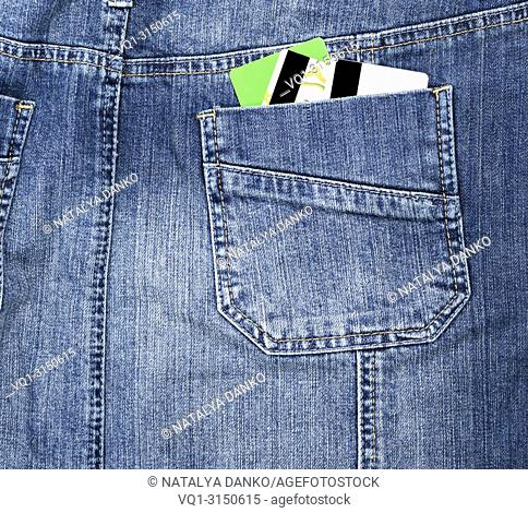 plastic credit card in the back pocket of the jeans, full frame