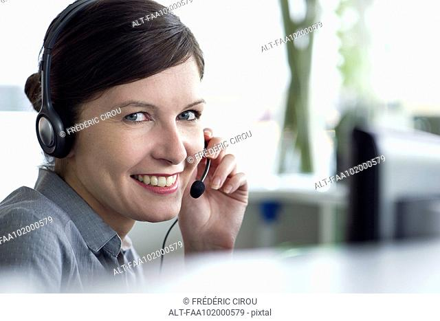 Receptionist smiling cheerfully