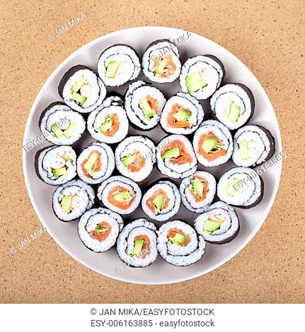 Plate of Sushi rolls, over wooden background