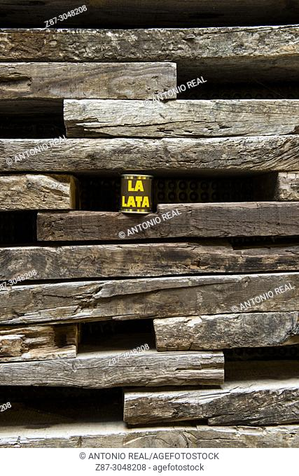 Wall decorated with railway sleepers. La Casa Negra (The Black House). Almansa. Albacete province. Spain