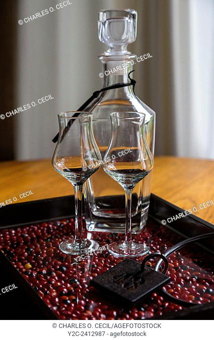 Peru, Machu Picchu Pueblo. Pisco Brandy in Decanter with Glasses and Room Key