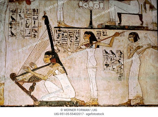 A detail of a wall painting in the tomb of Rekhmire showing women playing the harp, lute and tambourine