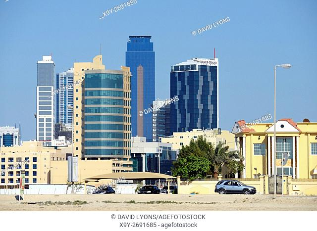 Manama, Bahrain. Seef district. Looking east to the Ramee Grand Hotel and the Almoayyed Tower aka the Dark Tower