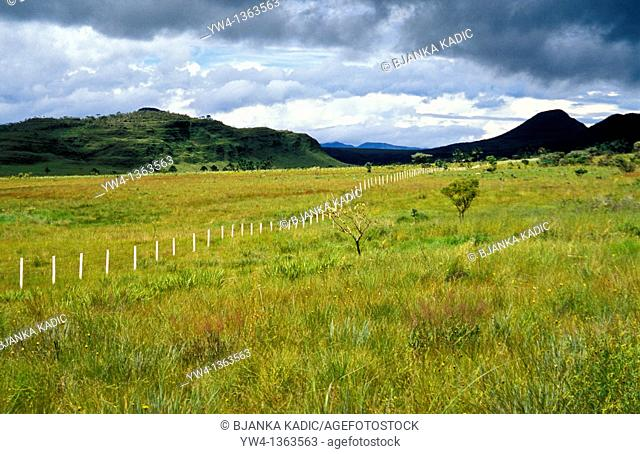 Riacho Fundo with black mountain and white fence, Chapada dos Veadeiros, Goias, Brazil,