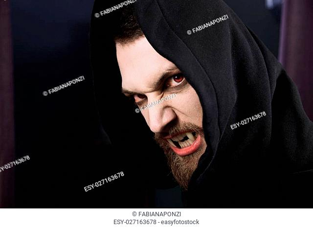 Male vampire ready to attack and eat blood
