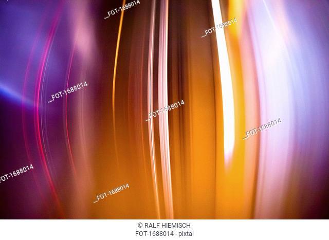 Full frame abstract image of orange light trails