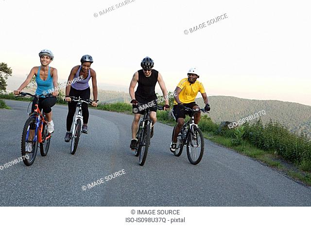Four cyclists on the road