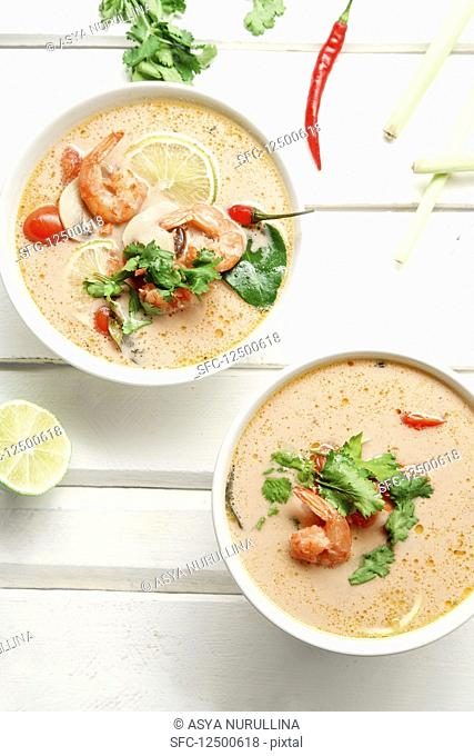 Traditional thai soup tom yum with shrimps and mushrooms