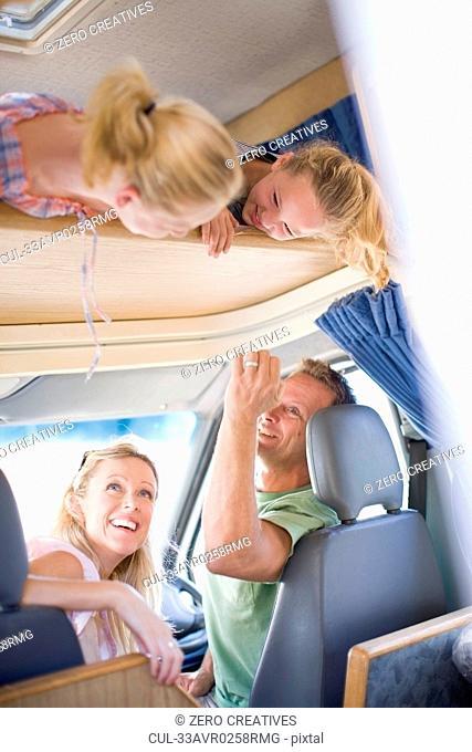 Family smiling in RV