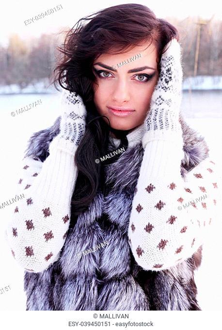 portrait of a woman in a fur vest
