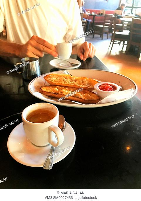 Spanish breakfast: cup of coffee and bread with olive oil and tomato. Spain