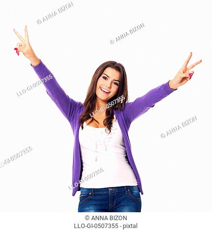 Smiling woman showing victory sign, Debica, Poland
