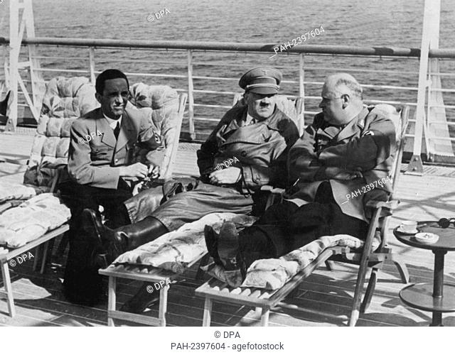 (L-r) Reich Propaganda Minister Joseph Goebbels, Adolf Hitler, and Reich Governor Röver on the deck of a ship (undated). - /Germany