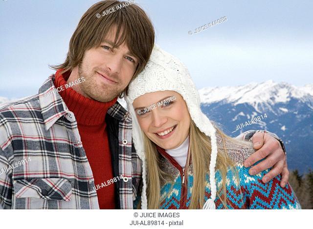 Couple hugging, Luesener Alm, Dolomite Alps, South Tyrol, Italy