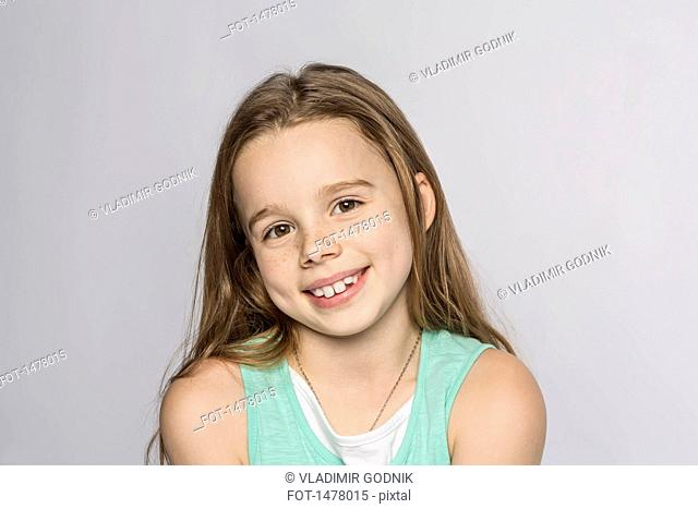 Portrait of happy girl against white background