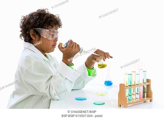Boy playing scientist