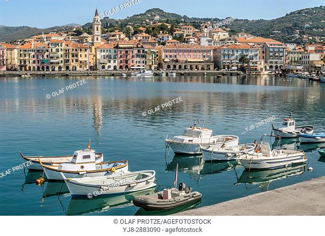 Fishing Boats in the Harbor in front of the old town of Oneglia in Imperia at the Ligurian coast, North West Italy