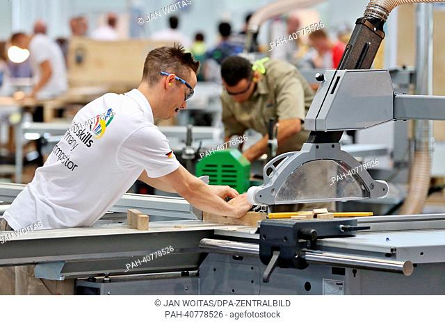 """German carpenter Peter Krauss competes in the discipline furniture cabinet making at """"""""WorldSkills Leipzig 2013"""""""" at the convention center in Leipzig, Germany"""