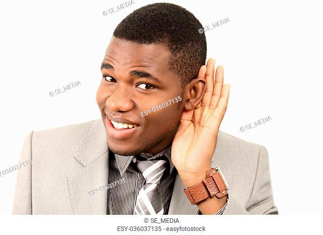 Listening man cupping ear