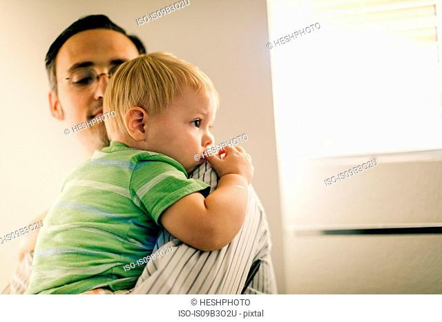 Father holding young son