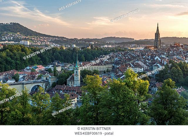 Switzerland, Bern, cityscape with Nydeggkirche and minster in the evening