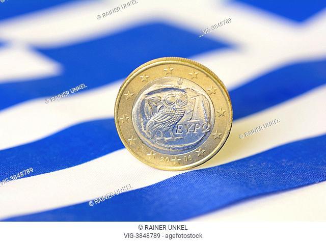 GERMANY, BONN, GERMANY : A greek Euro and a flag of Greece - Bonn, Northrhine-, Germany, 01/08/2013
