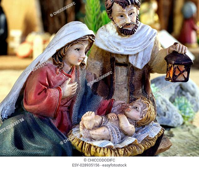Nativity scene jesus child with Mary and Joseph with the lantern symbol of light and hope