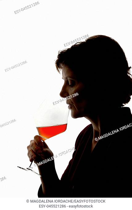 Silhouette of Woman drinking wine on white background