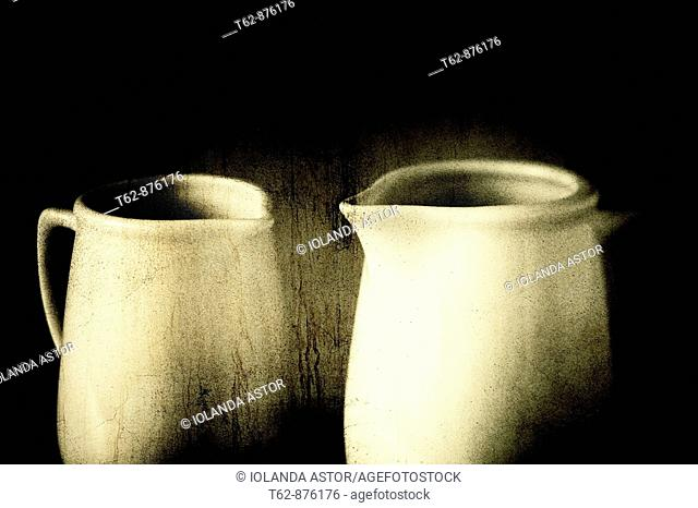 Two white mugs with steaming hot drink.  Old texture.  Still Life