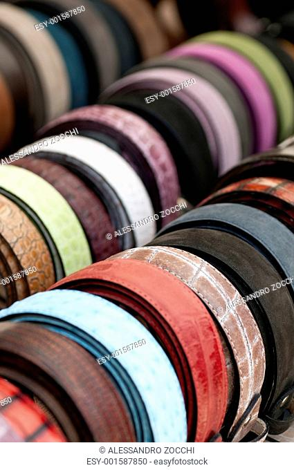 Leather belts of various colors on display