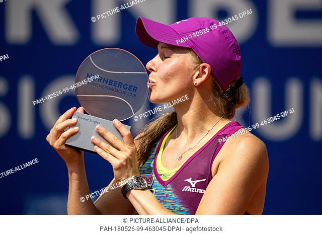 26 May 2018, Germany, Nuremberg: Tennis, WTA-Tour, women's singles, final. Sweden's Johanna Larsson kisses her trophy after winning against Alison Riske from...