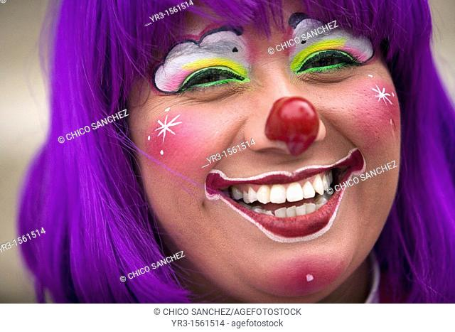 A female clown smiles during the 16th International Clown Convention: The Laughter Fair organized by the Latino Clown Brotherhood, in Mexico City, October 17