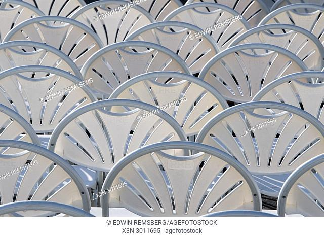 Plastic chairs put in orderly lines forming a pattern, Greensboro, North Carolina. USA