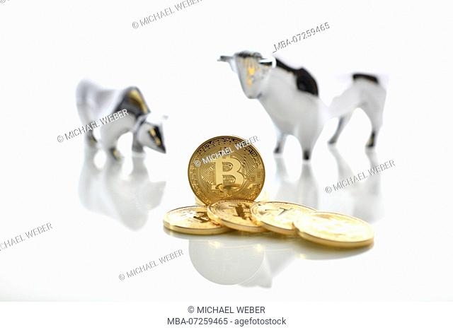 Symbolic stock price digital currency, golden physical coin bitcoin, bull and bear