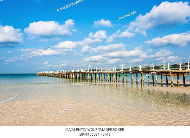 Pier on beach with turquoise water at Saracen Bay on Koh Rong Sanloem island, Krong Preah Sihanouk, Sihanoukville, Cambodia