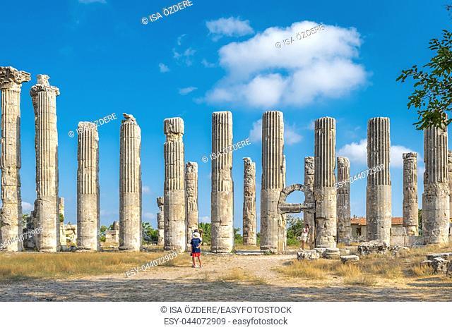 Unidentified tourists walking and exploring Zeus temple at Uzuncaburc Ancient city located in Uzuncaburc,Silifke,Mersin,Turkey. 29 August 2017