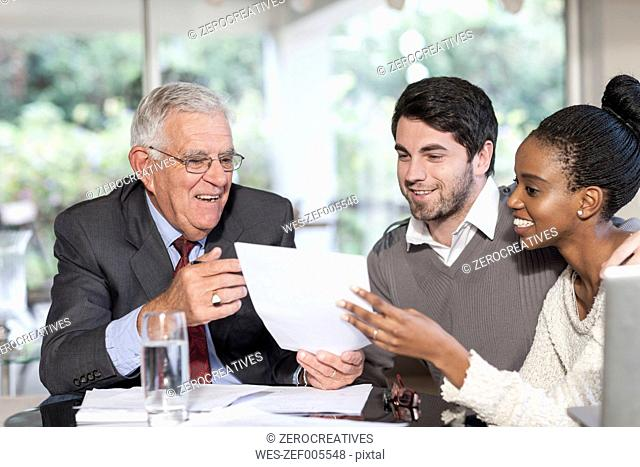 Young couple having a meeting with a salesman